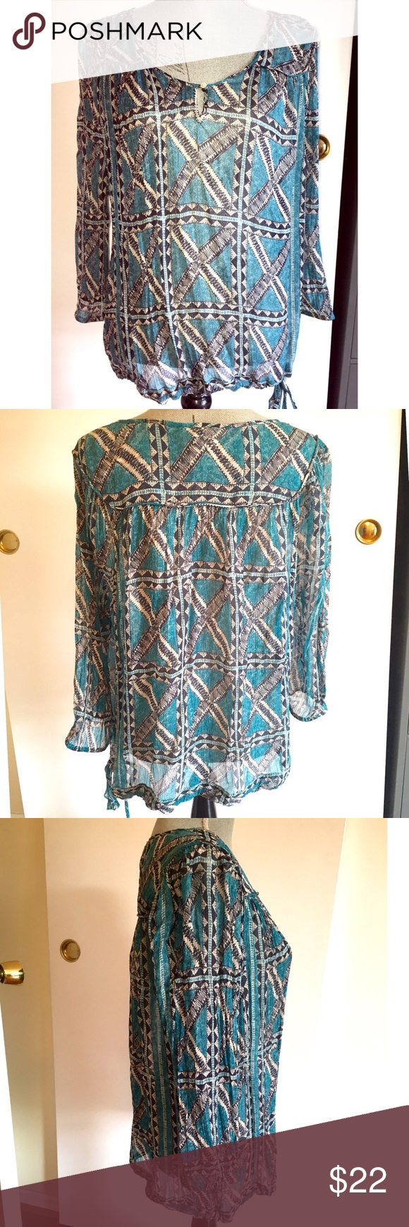Semi Sheer Peter Dunham for Lucky Brand blouse Beautiful Crinkled Teal, Ivory and Navy Geometric printed blouse. Tie waist, lightly cinched 3/4 sleeve.  *Note -Care label  has been cut off since it was visible when worn - item is dry clean only.  Button loop at neck.   In Very Good shape, gently worn once. Lucky Brand Tops Blouses