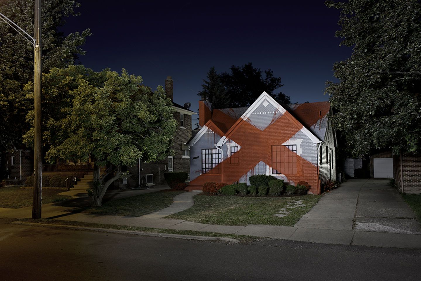 Suburban is a multifaceted photography, film, installation exhibition by artist Ian Strange.