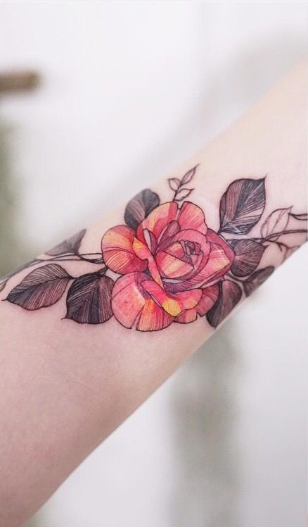 Rose And Leaves Tattoo That Wraps Around The Wrist And Inner Arm