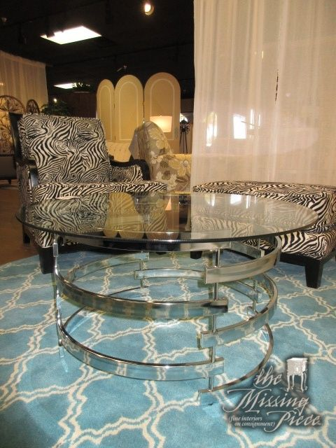 """Glass top coffee table on a round chrome base. Cool, contemporary style! Measures 35""""round x 18""""high. Excellent price as well. Arrived: Friday December 2nd, 2016"""