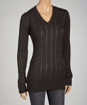 When the day calls for cozy-chic staples, this sweater makes a stellar selection. The soft acrylic knit, timeless v-neck and fitted shape fill it with classic charm, giving this piece a polished, put-together look.