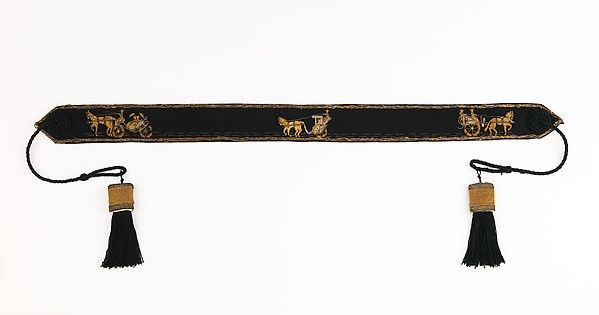 1945Hermés is a purveyor of fine leather goods/clothing/accessories of the highest quality. The company began as an equestrian leather goods maker, 1st supplying harnesses to coach builders. The house's logo is a horse-drawn carriage & this belt is a signature piece portraying 3 different scenarios. 1st is of two women riding in a carriage holding their parasols; 2nd of 2 people, 1 seated & 1 standing while driving the carriage; & 3rd of a man driving a covered carriage w/ a female…