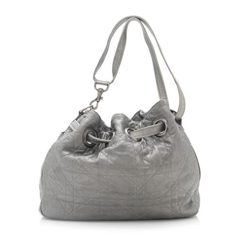 0dfe5c5fa50 This Dior tote is made from silver cannage quilted leather with antique…