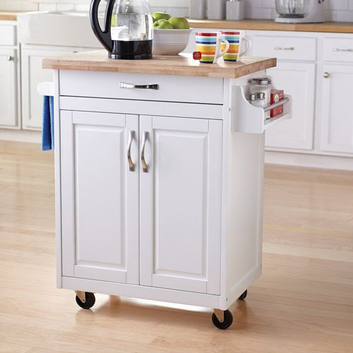 """Mainstays Kitchen Island Cart, Multiple Finishes (00065857165265) Mainstays Kitchen Island Cart, White: Portable kitchen island cart with solid wood top Natural finish Durable casters for mobility Towel bar and spice rack Drawer and cupboard for ample storage options Assembly required 1-year limited warranty Dimensions: 32""""W x 19""""D x 35.5""""H Model# WM6545W Ideal for meal prep or storage Designed to blend easily with almost any existing kitchen decor Features drawer and cupboard Drawers and…"""