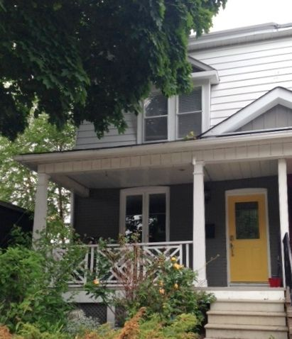 painted house makeover: yellow front door + gray brick | Porch ...