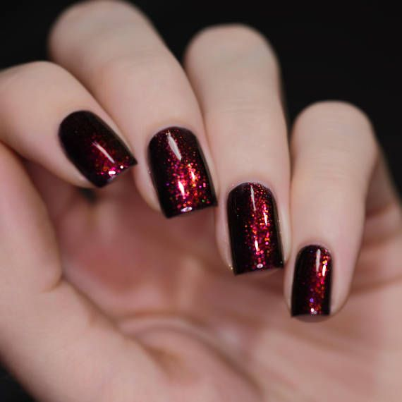 A true knockout, Lights Out is a rich black shimmer nail polish with ...