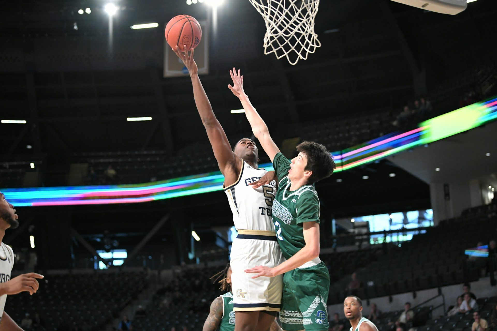 Tech Basketball Downs College in