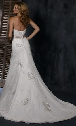 Maggie Sottero 408130 10: buy this dress for a fraction of the salon price on PreOwnedWeddingDresses.com