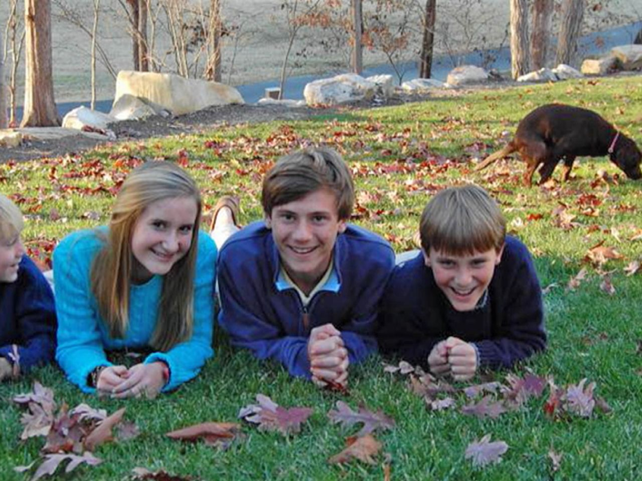 Photobomb! Dog answers nature's call in family portrait
