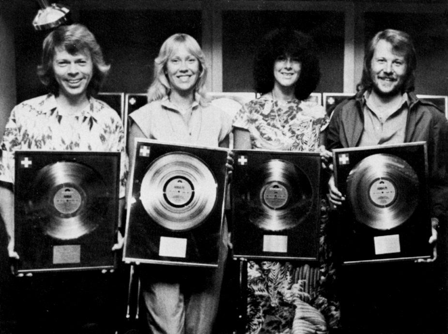 """ABBA received gold record for their sales of """"Greatest Hits Vol. 2"""" in Switzerland. The Swiss press took pictures during awarding ceremony in the Polar studios in Stockholm 1980"""