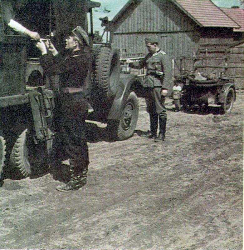 Lieutenant Helmut Ritgen receives food in a field kitchen