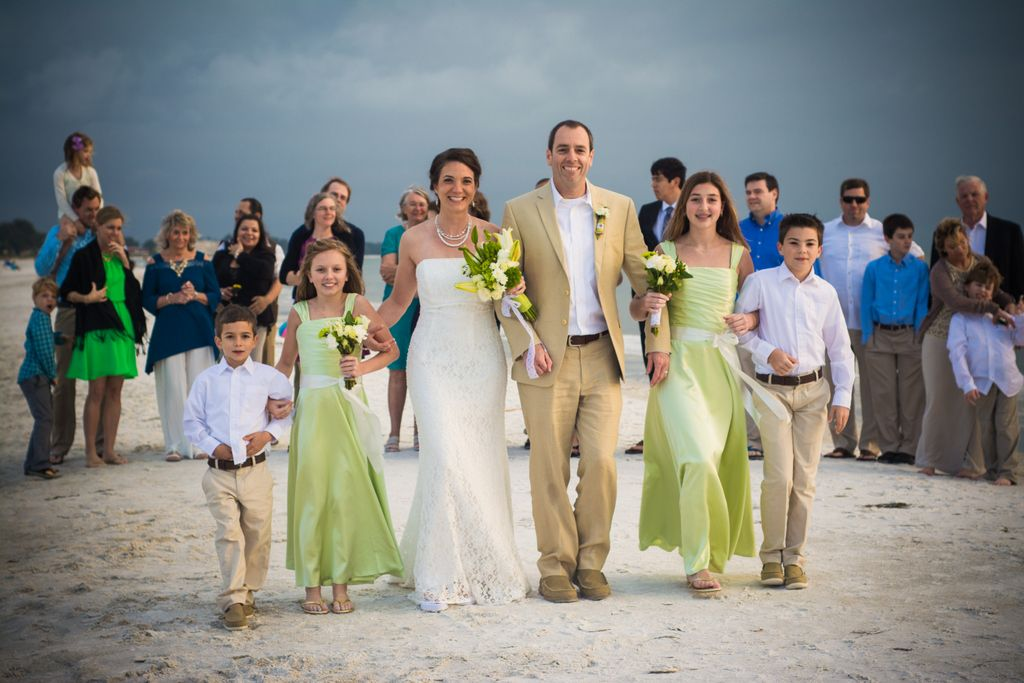 Beach wedding w pistachio bridesmaid dresses and linen groom and groomsman suits