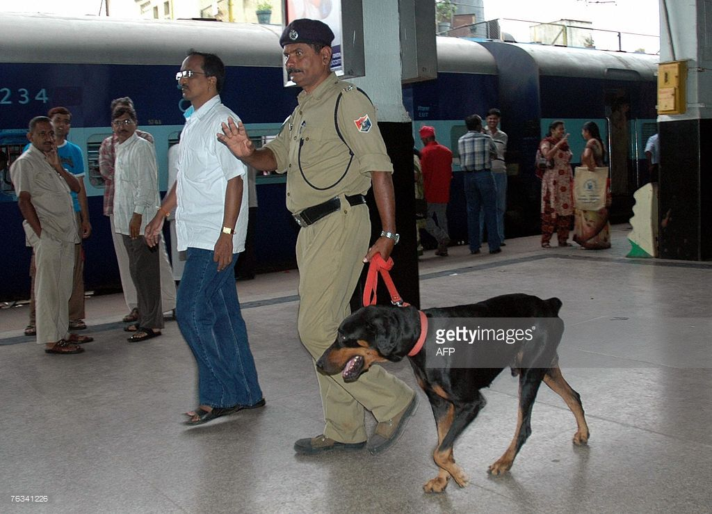 Indian Railway Police use a sniffer dog to check out the