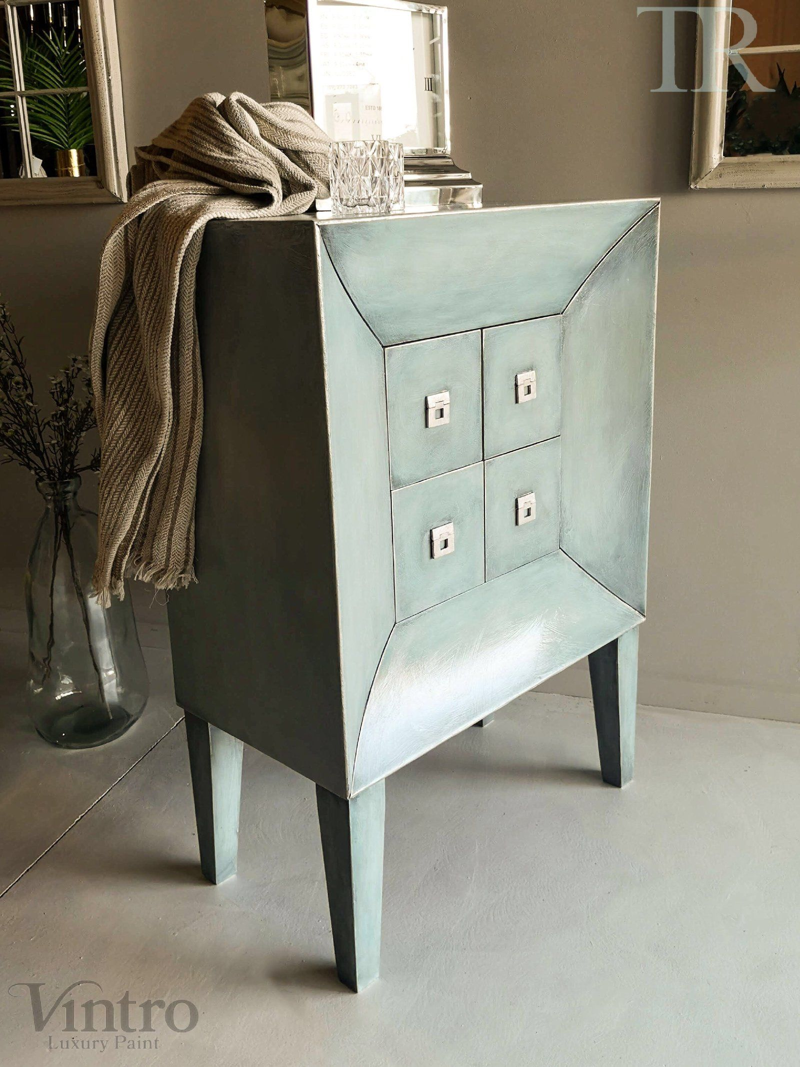 Commissioned drawers in layered blues with a subtle black