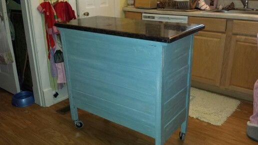 Old dresser made into a kitchen island with leftover granite