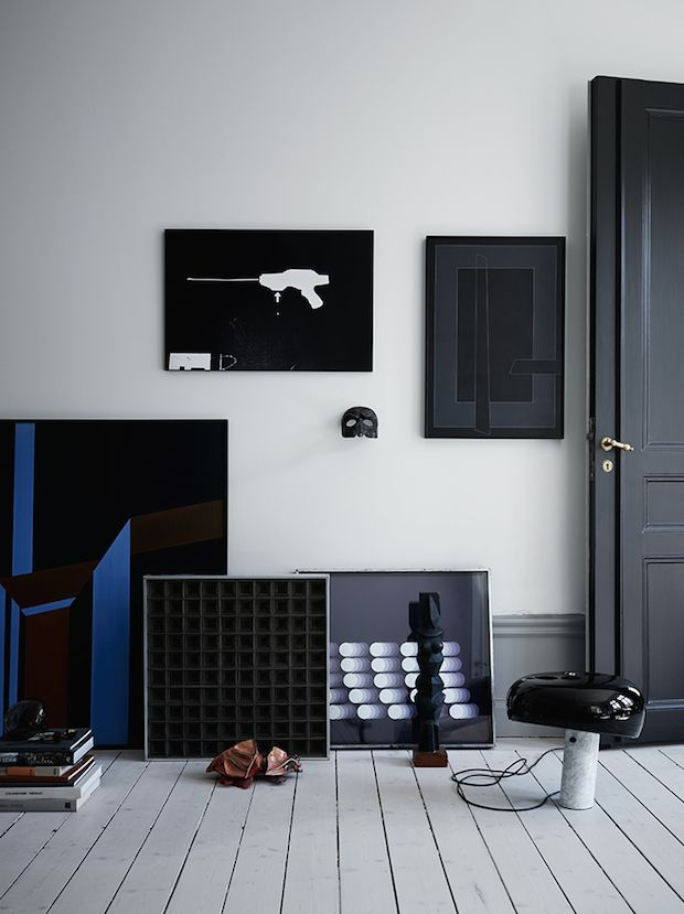 Art And The Snoopy Light By Flos In A Black And Navy, Elegant Swedish Home