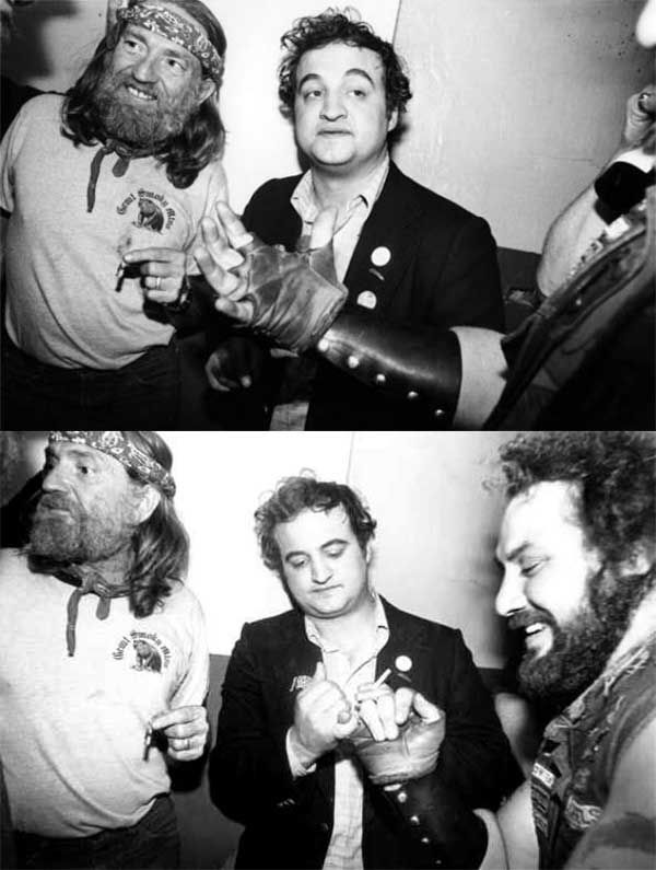 Willie Nelson sharing a joint with John Belushi as he pinkie swears with a Hells Angel after a taping of SNL.