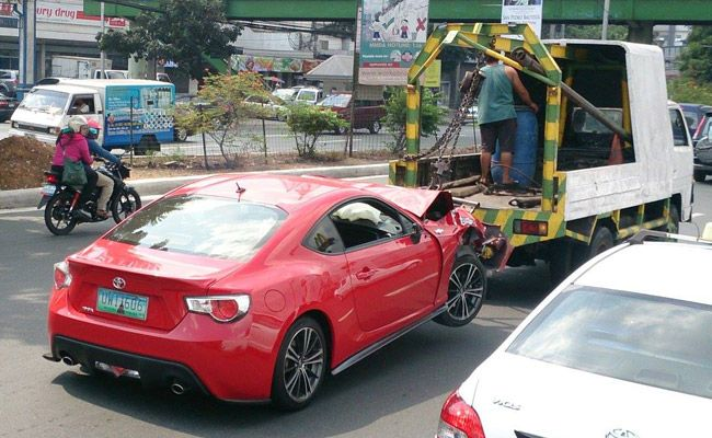 A Wrecked Red Sports Car Is Never A Good Sight To Behold