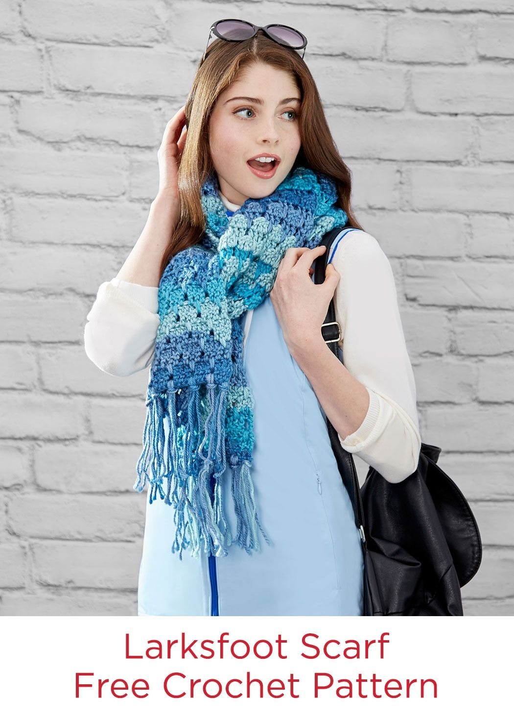 Larksfoot Scarf Free Crochet Pattern in Red Heart Soft Essentials yarn -- The striping colors do all the work for you! The easy-to-learn crochet stitch means you'll have a scarf that will carry you through the cold weather season in style in no time!