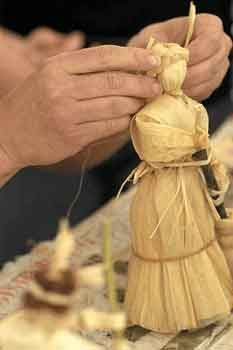 Imbolc is celebrated with candles and grain dolls made of dried sheaves of corn or wheat from last year's harvest.  They can be simple or fancy.