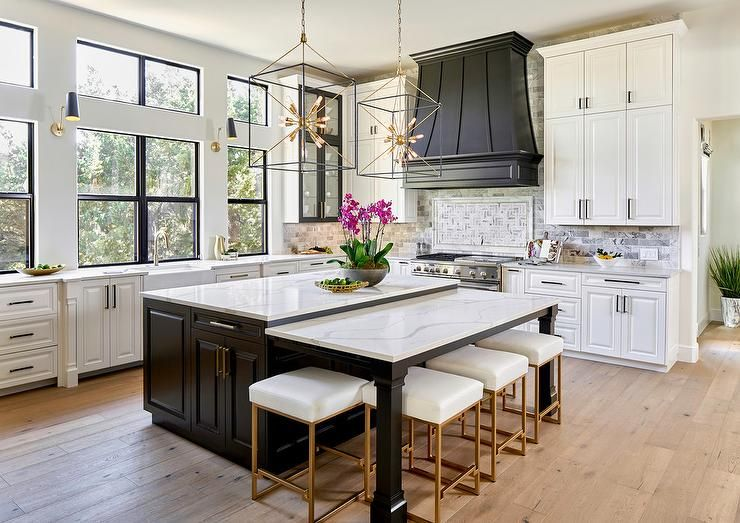 Drop Down Island Dining Table Topped With White Quartz Countertops Paired With White And Gold Backless Counte Classy Kitchen Luxury Kitchens Home Decor Kitchen