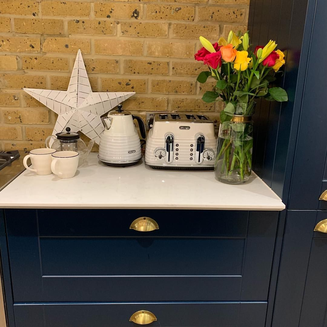 Navy kitchen inspo with matching appliances navy