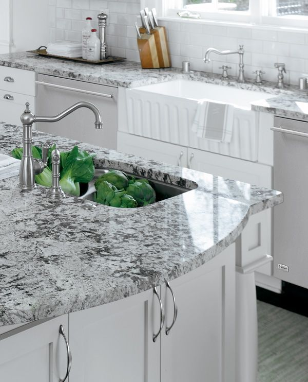 White cabinets and a farmhouse sink with black and white ... on Farmhouse Granite Countertops  id=63254