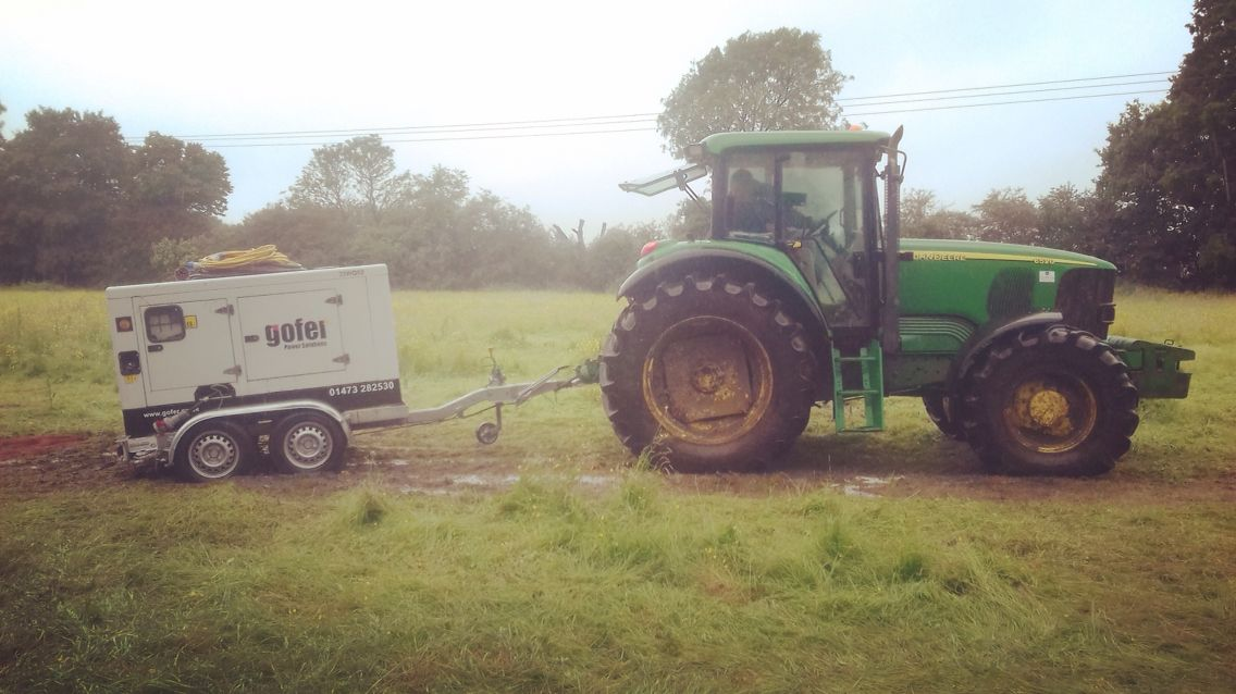 Gofer generator being towed by a tractor. Mud isn't an