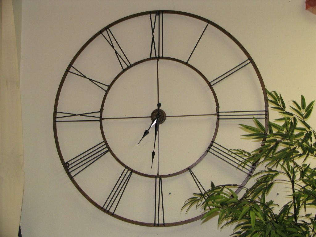 Inexpensive Wall Clock Using Large Wall Stickers With Appropriate Subject And