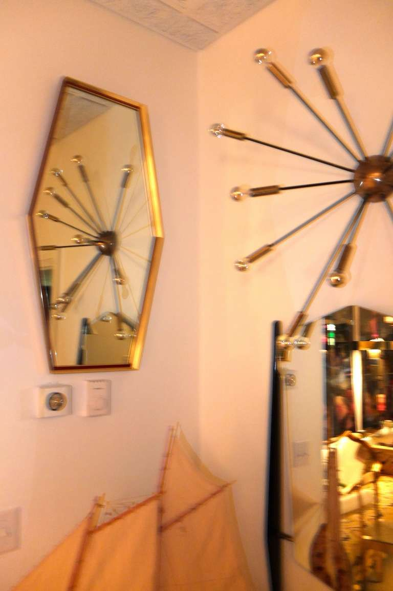 Brass Framed Boat Tail Wall Mirror by Turner | Mid century and Walls