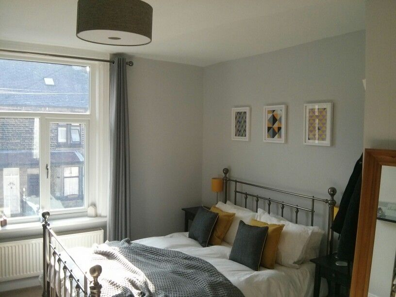 Bedroom finished grey with mustard as the accent colour