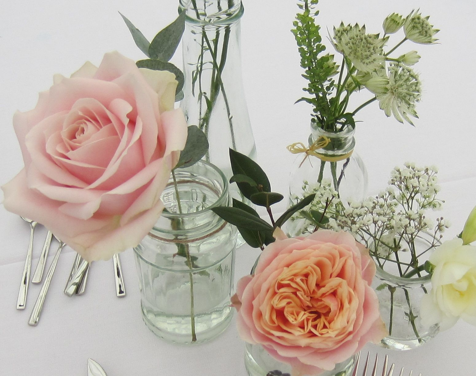 Small Vases Of Vuvuzela And Sweet Avalanche Roses Gypsophila