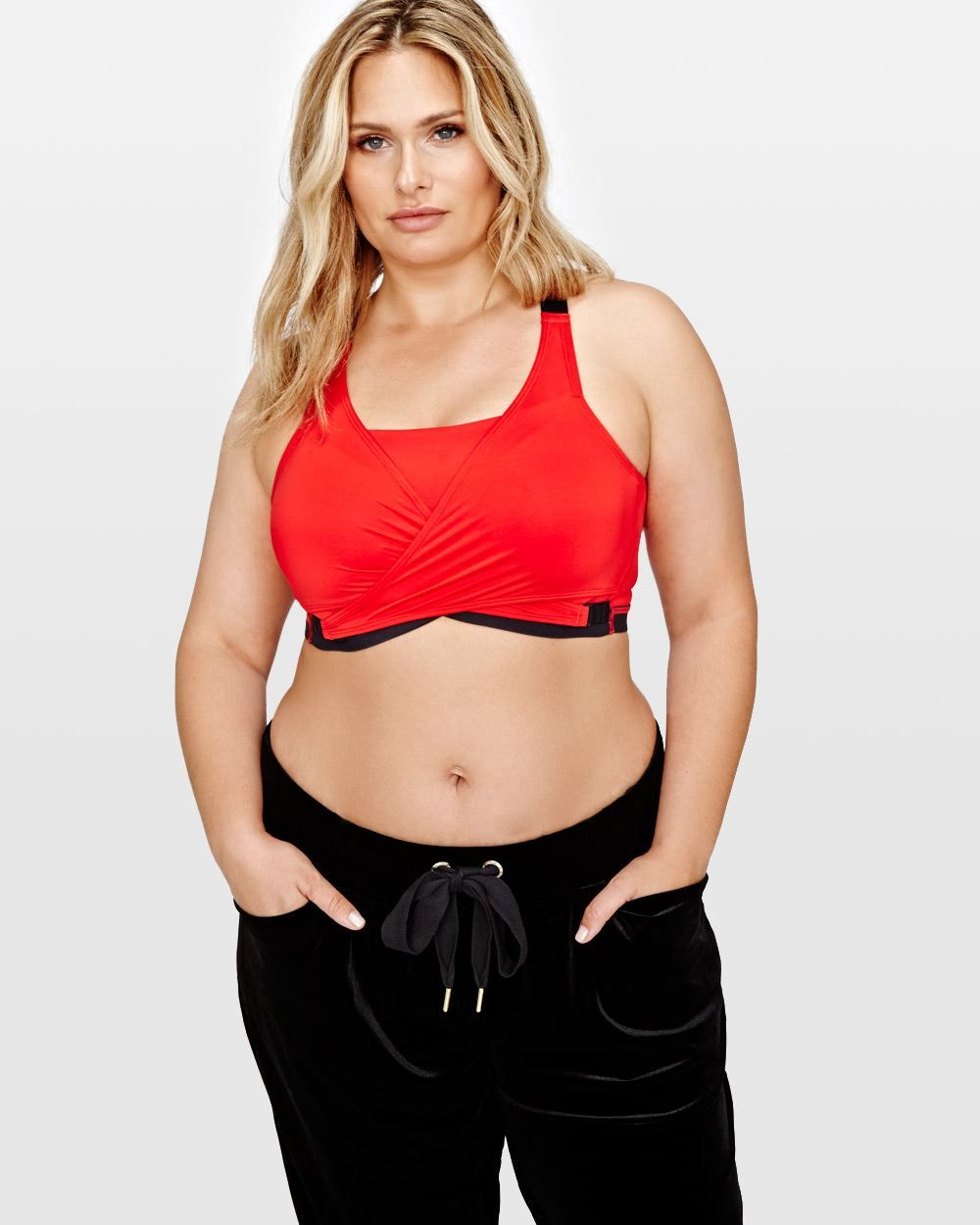 bb78ce2d0 You ll be the envy of your Zumba class with this two-layer plus size sports  bra by Nola! Featuring high front coverage for full support and for reduced  ...