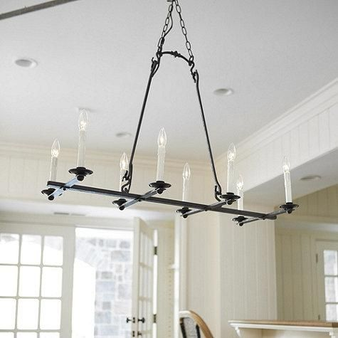 This hand forged iron chandelier has classic ball and rivet details ...