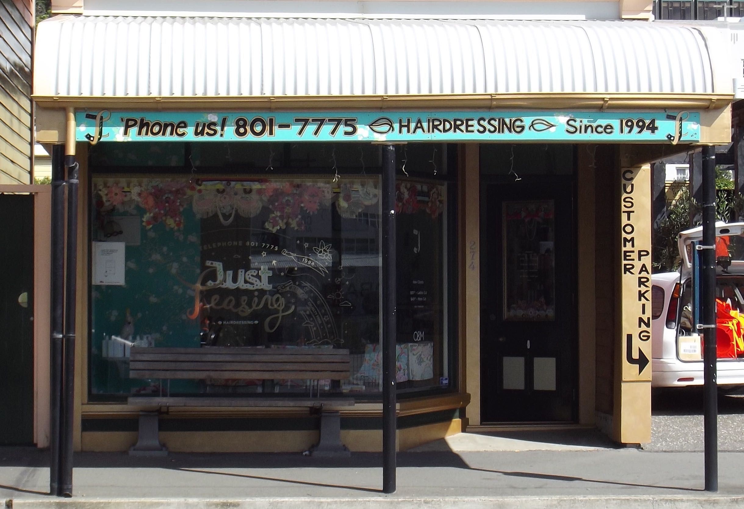"""More signage for """"Just Teasing"""" Hairdressing, 247 Willis st, Wellington. View from the street."""