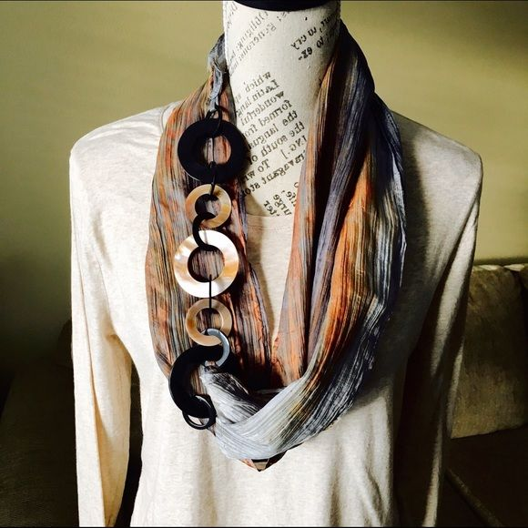 """SOLD 100% Natural Hand Dyed Silk Scarves Please inquire about availability. Hand dyed marble grey 100% natural silk infinity scarf. Decorative shell links connect the tapered layers of this unique scarf. Links can be used on either side for a different look. Dry clean. Links and watercolor pattern may vary based on actual scarf due to the hand-dyed preparation.  Approx. 68"""" long (around) and 6"""" wide. Triple layers connected along center line. Initial price will be firm based on…"""
