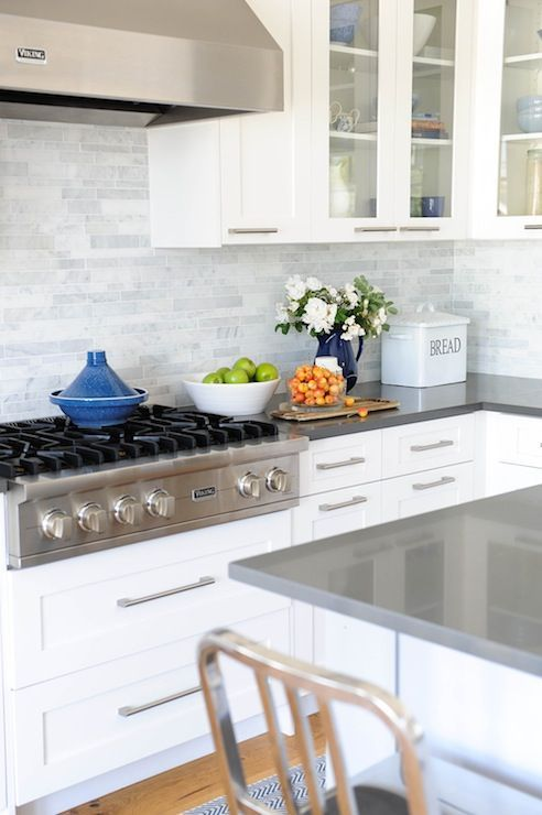 White cabinets marble linear backsplash gray quartz Backsplash ideas quartz countertops