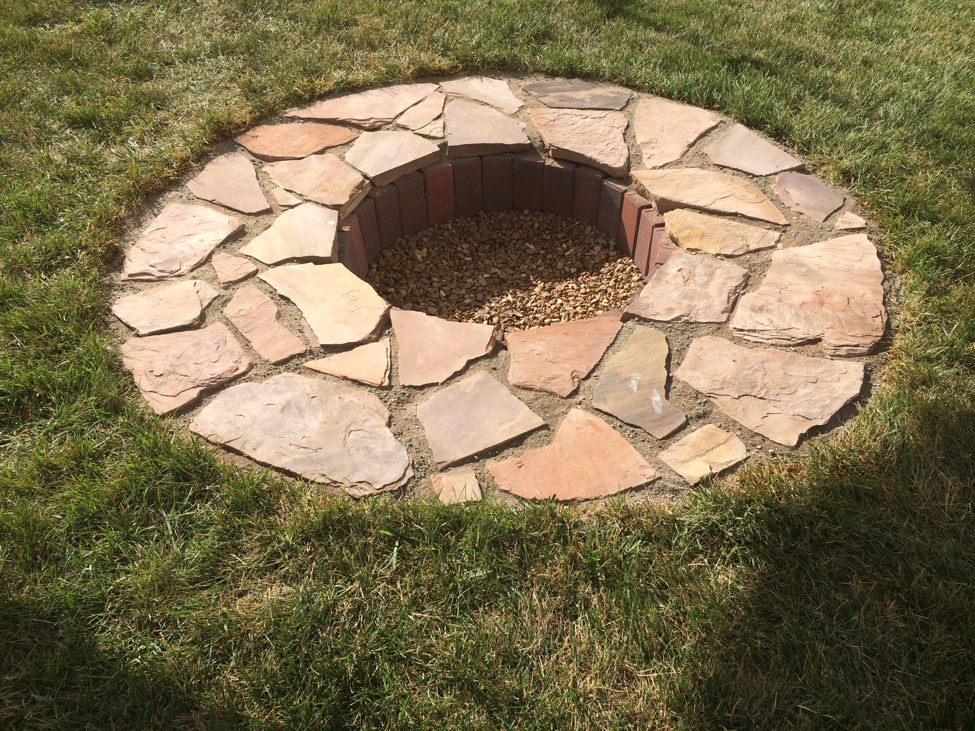 in ground fire pit made from flagstone and pavers really cool