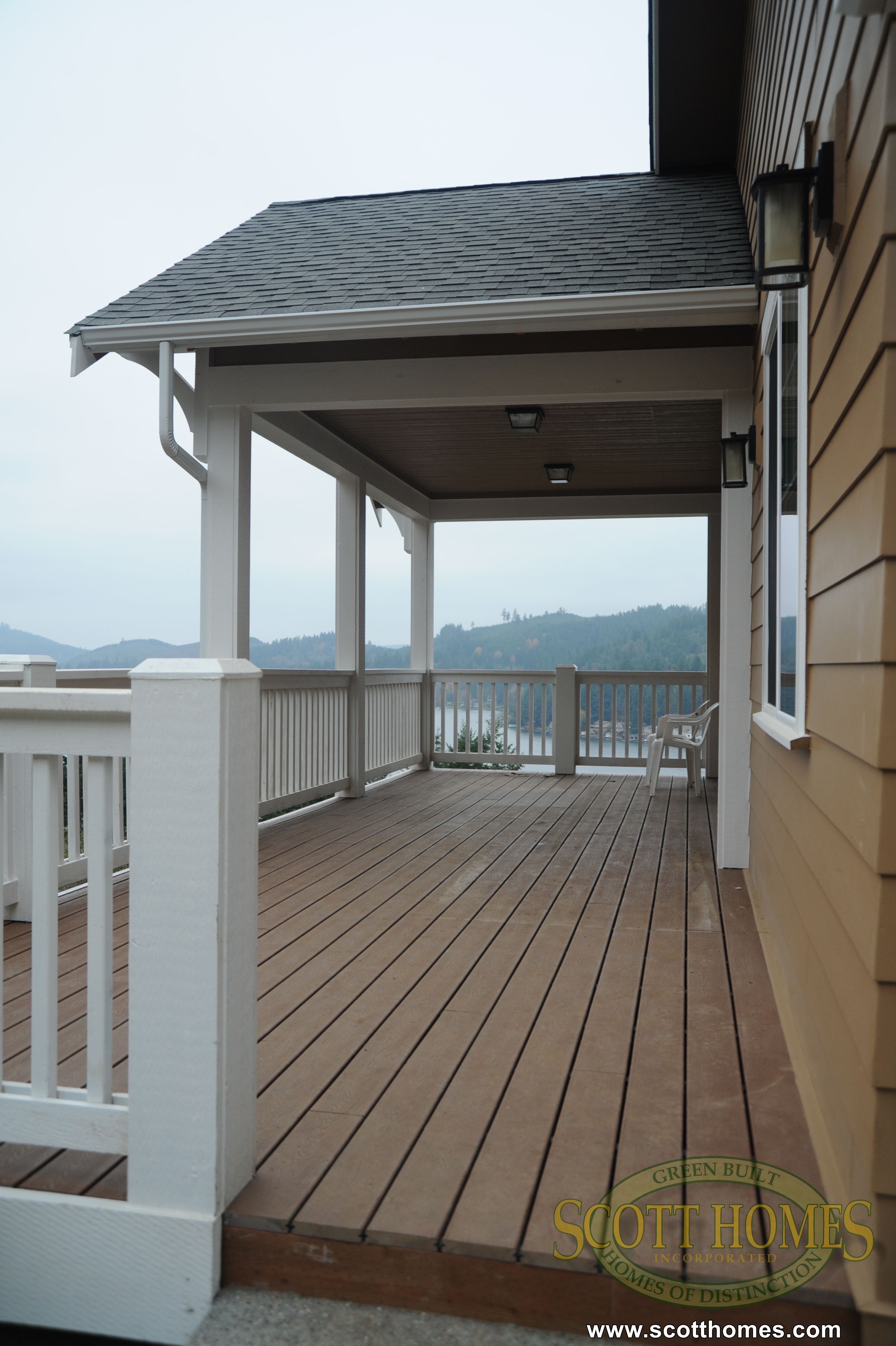 the split level home is overlooking the water two balconies lend to