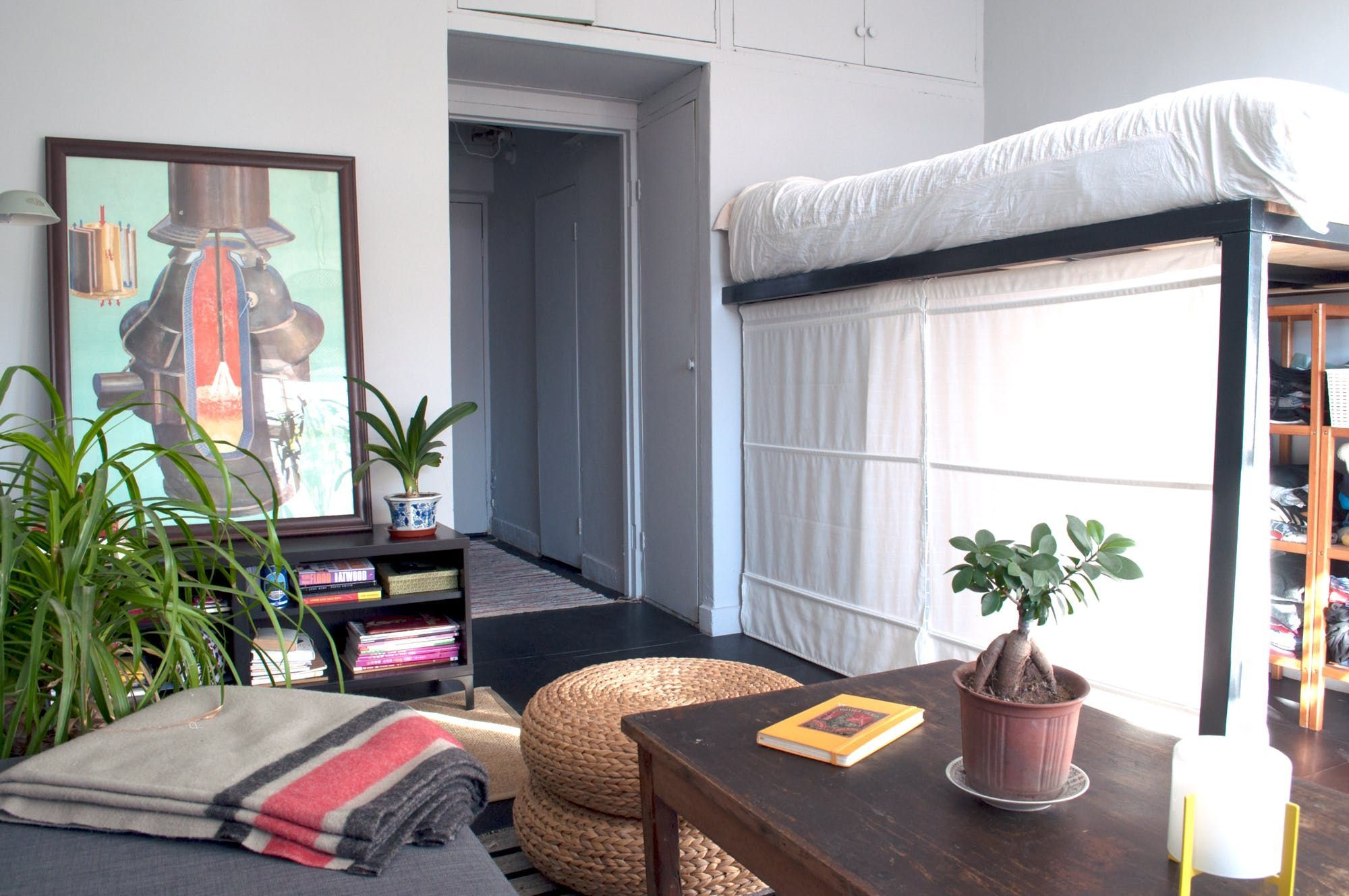 Loft bed curtain ideas  A white curtain from IKEA separates the wardrobe under the loft bed