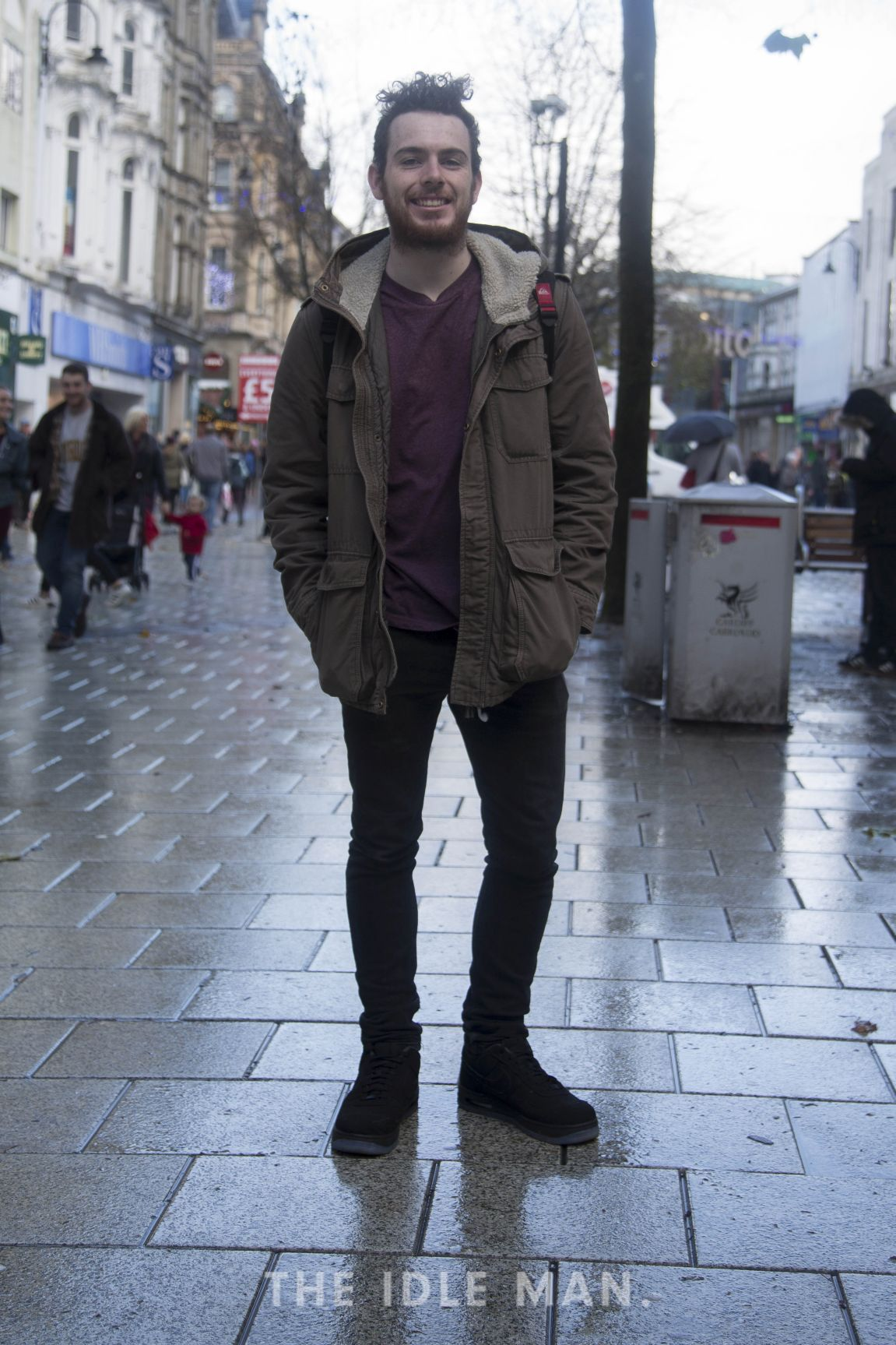 Men's street style, a classic green parka and slim fit jeans with ...