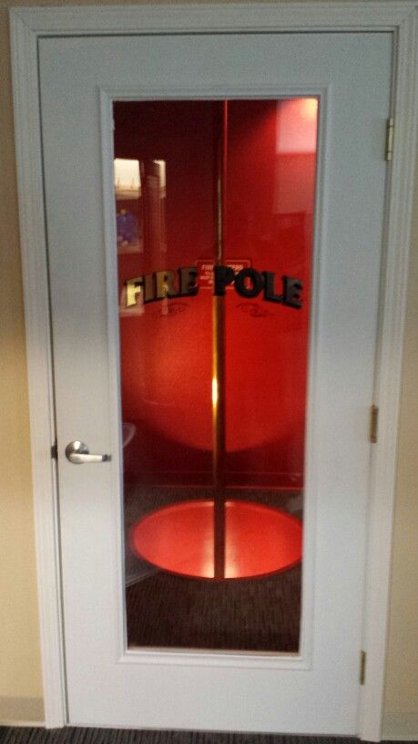 Man On Fire Pole : Fire pole behind glass door with gold leaf homes