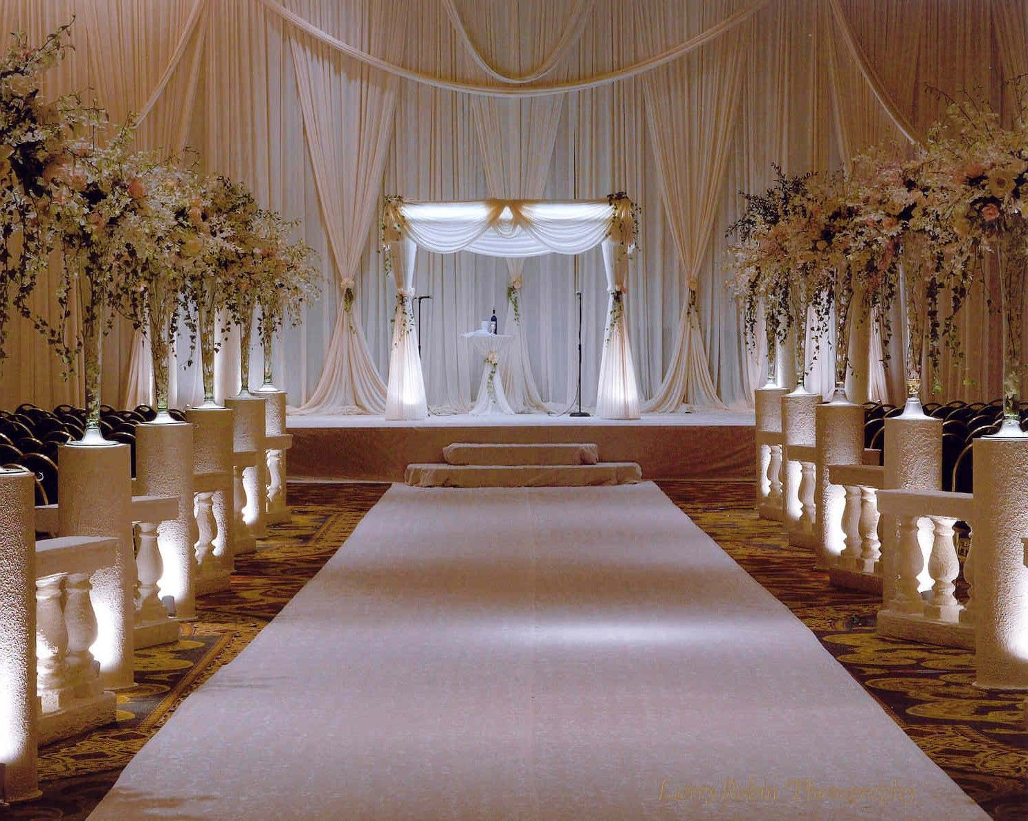 Elegant white hotel ceremony decor wedding ceremony for Hotel wedding decor