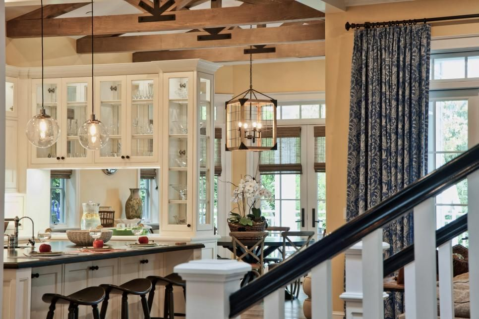 mixing glass pendant lights and a rustic caged chandelier