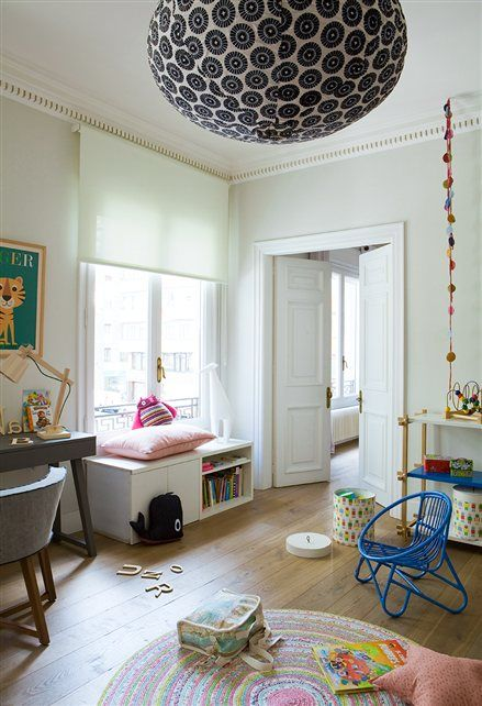 Child's bedroom with bold printed lantern and bench under the window. #kids #decor