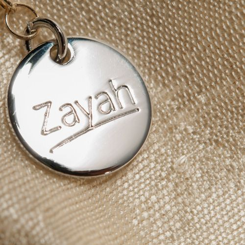 Welcome to Zayah Jewellery. Every  premium necklace and bracelet will have this beautiful metal tag so that you've got a designer logo on your jewellery.