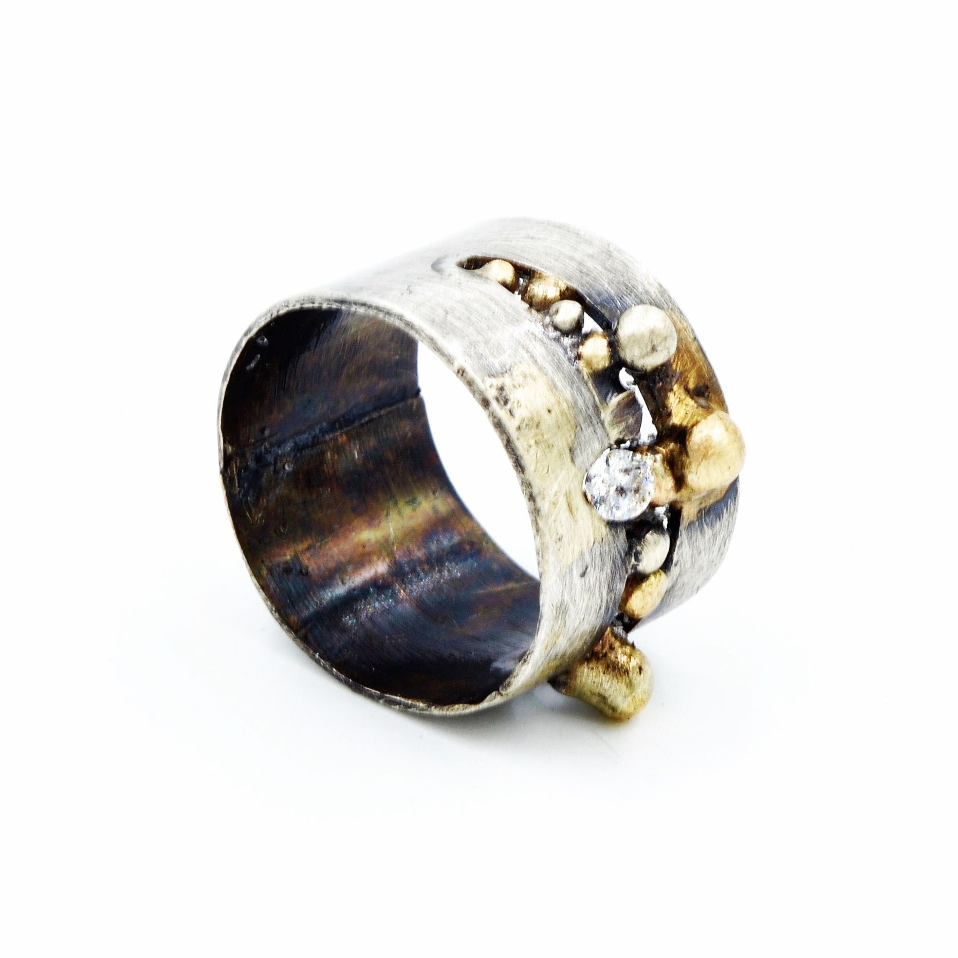 Oxidized and aged Sterling silver and 18 carat Gold ring, set with silver and gold drops and a Swarovski CZ