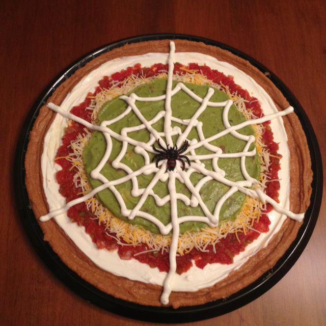 """""""Halloween"""" Mexican Dip.  I finally used an idea that I found on Pinterest.  It was a BIG hit at last night's party!  Use any recipe you want.  This is just a visual."""