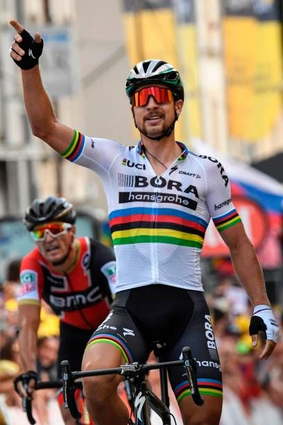 c5671484b Slovakia s Peter Sagan celebrates as he crosses the finish line ahead of Belgium s  Greg Van Avermaet at the end of the 2125 km third stage of the.