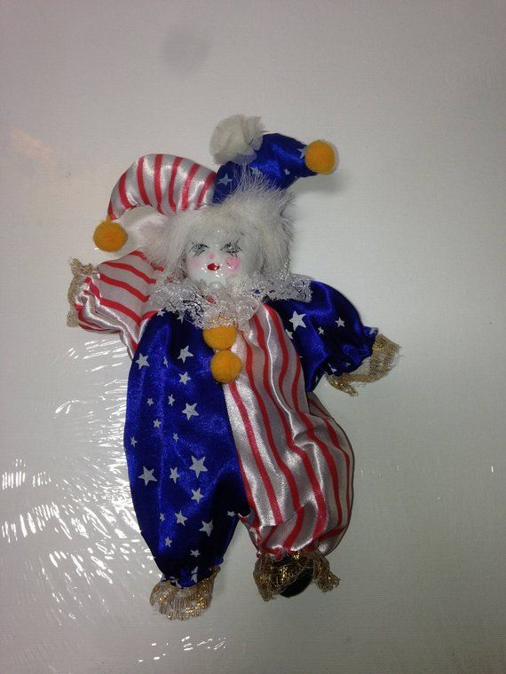 miniature porcelain clown doll in red, white & blue striped outfit